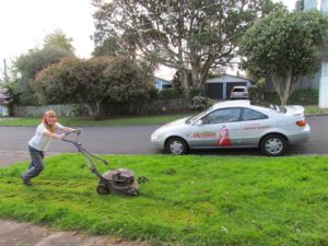 Cr Cathy Casey gets to work mowing her berm