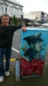 Christopher Dempsey with a painted utility box in Parnell
